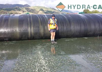 de-sludging-worker-by-water-bags-being filled