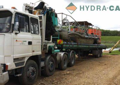 de-sludging-truck-carrying-boat