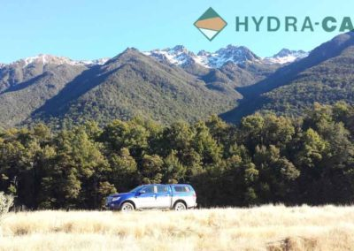 Work ute in front of snow capped mountains in New Zealand